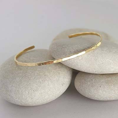 2. Kristen Briggs Jewelry Design Thin Hammered Gold Cuff